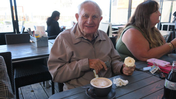 Customer Ron Coleman tucking into an ice cream and coffee at Whitstable Harbour (2)