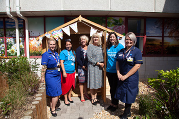 Representatives from Encore Care Homes recently attended a summer garden party at the Royal Bournemouth Hospital to mark the opening of a dementia-friendly summerhouse which they donated to the Bournemouth Hospital Charity.