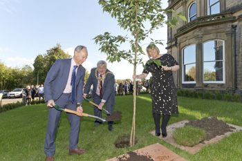 Paul Shevlin, Chief Executive of Craven District Council plants a tree to commemorate the opening with Peter Corkindale, Mayor of nearby Keighley and Lisa Gardner, Service Director at Malsis Hall.