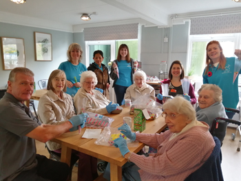 Residents from Sunrise of Bagshot care home recently spent time at Sebastian's Action Trust's family outreach centre – The Woodlands – filling sweet cones in preparation for the charity's Christmas Market.