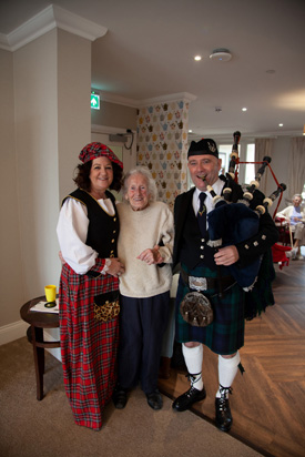 Michele Blake (Wellbeing Manager) June DeMarco (resident) and local musician Alan Cowie.