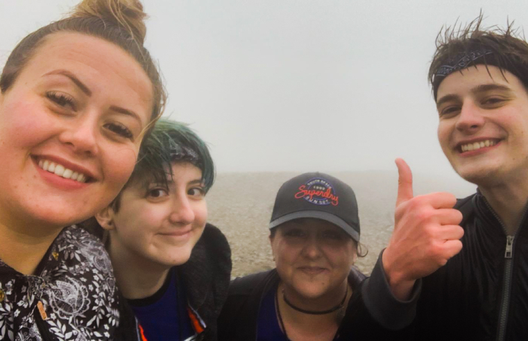 Four care workers from the Kanner Project in Plymouth have scaled Mount Snowdon to raise money for charity and a memorial for a colleague who passed away in August.