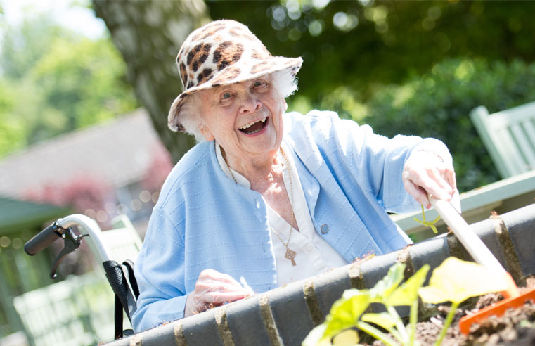 A resident at RMBI Care Co. Home Connaught Court enjoying some gardening.