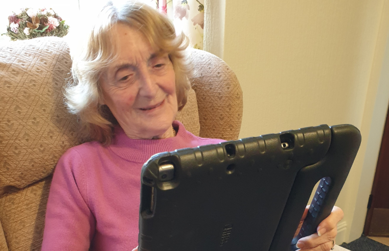 Czajka Care Group resident Peggy Brayshaw enjoys a 'virtual visit'