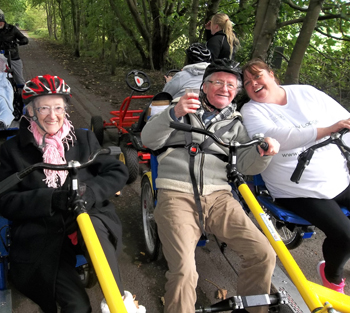 Elderly care home residents have cycled over 14 miles, raising over £450 for an allotment and the Alzheimer's Society.